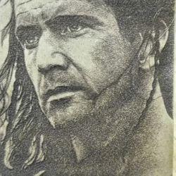 Immagine Mel Gibson riportata su legno tramite macchina laser